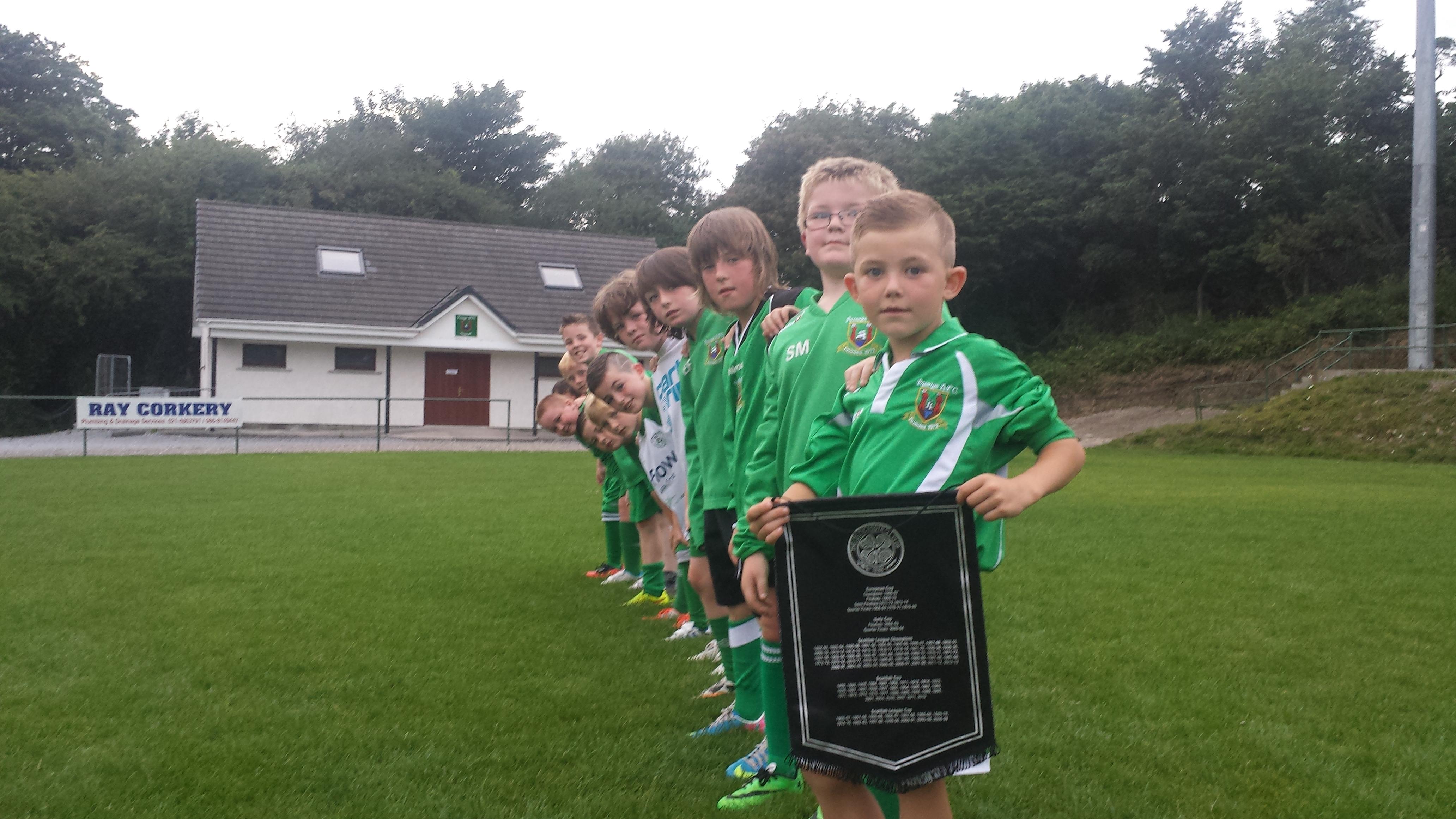 Passage AFC players embrace Celtic FC